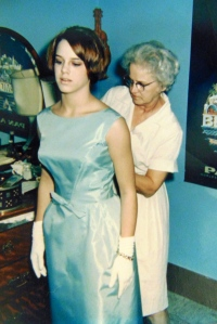 The wished-for dress for my first formal, 1965, my mother completing the finishing touches