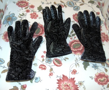 "The glove on the left is the old glove, kept after the last loss ""just in case""--and wore it accidentally with a new one today. A bonus glove :)"